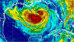 Massive tropical storm Isaac aims at New Orleans, forecast to strengthen to categ